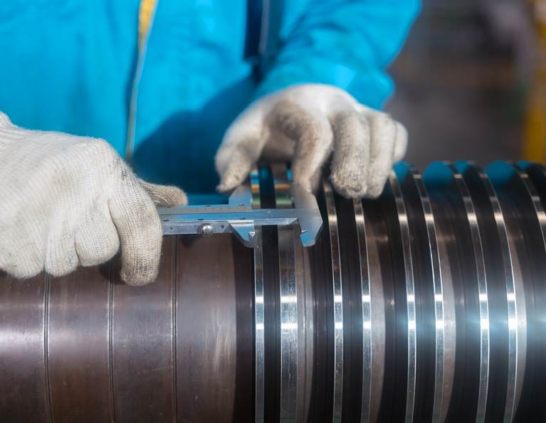 Person working on machine repair representing adhesives for MRO.